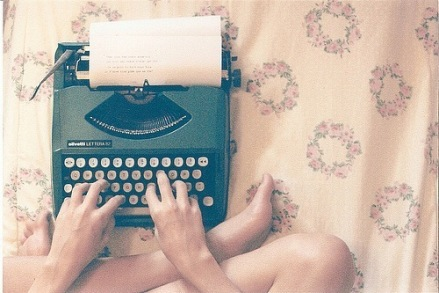 writer on a typewriter